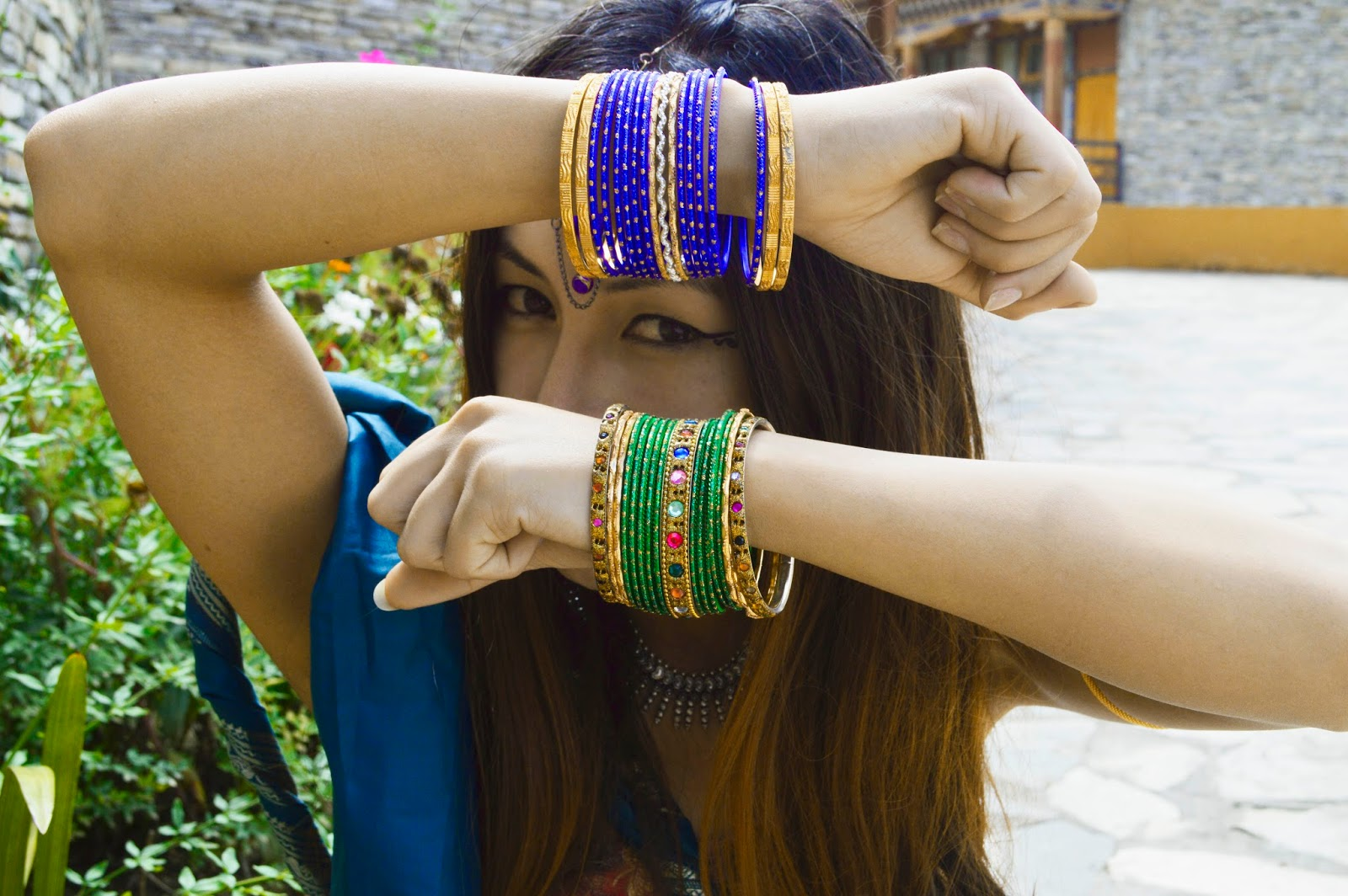 girl with bangles in hand | SAN