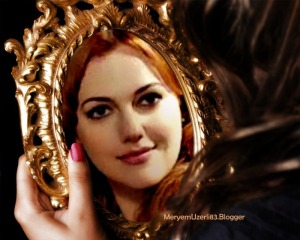meryem_uzerli-beautiful girl in looking at mirror